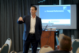 Jim Harshaw speaking in front of his clients (#289 Cheatsheet: 17 Tactics for Starting a Successful Side Hustle in 2021)