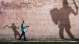 A David and Goliath-like image: The small man ready to take on the big challenges in his life (Success Through Failure episode 302: Overcoming Your Fear of Setting Scary BIG Goals: How to Set Your BHAG)
