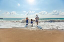 A family enjoying the beach (Success Through Failure episode 306: 14 Tactics Guaranteed to Help You Return from Vacation and Holidays Energized Instead of Exhausted, Driven Not Drained)