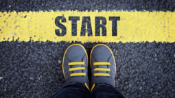 A boy standing at the starting line (Success Through Failure episode 317: Defeating Procrastination: Tactics to Boost Productivity Even When You Don't Feel Like It)